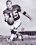 A photo of Bart Starr pitching the football towards the camera