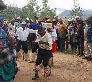 Morija Arts & Cultural Festival - Basotho men in a village near Nthabiseng, Lesotho dancing a traditional Men's Stick Dance
