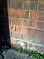Benchmark on the bus depot on Reckleford at junction with Gold Croft - geograph.org.uk - 2287260.jpg