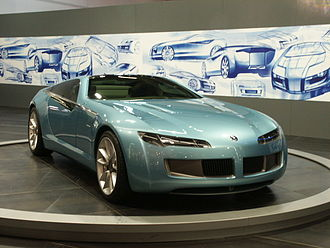 Automotive design - The 2003 Bertone Birusa concept car on display at an International Car Show. In the Background are some concept sketches