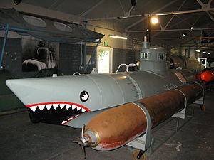 Biber (submarine) - Submarine No.105 with a torpedo mounted at the Royal Navy Submarine Museum.