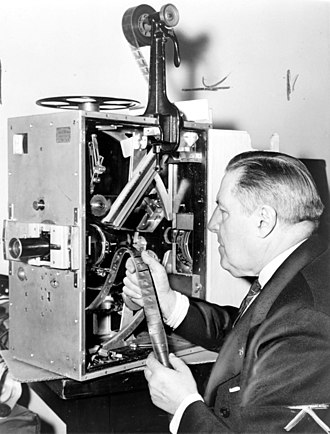 Billy Bitzer - Bitzer seated at movie projector