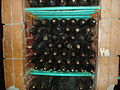 Bottles of wine in the wine cellars of Cojuşna winery (188832855).jpg