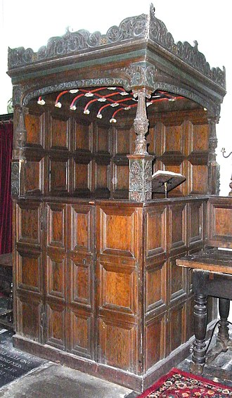"""Manor of Tawstock - The """"Bourchier Pew"""" (or """"Manorial Pew""""), north transept, St Peter's Church, Tawstock. Made in about 1550 in Franco-Flemish early Renaissance style, and decorated with Bourchier knots, it was used by the lords of the manor of Tawstock"""