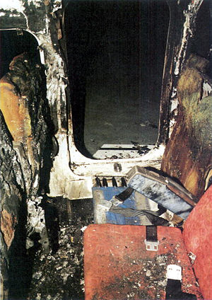 British Airtours Flight 28M - Photograph showing seats relative to the right overwing emergency exit after the accident. Note the position of the arm rest. The seat back for the seat closest to the window, seat 10F, was returned to its upright position before this photo was taken.