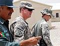 Brig. Gen. Nasrullah Zarifi shows Brig. Gen. John McGuiness and Col. Greg Baine around the training facility (4782317387).jpg