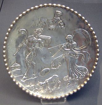 Mildenhall Treasure - One of a pair of silver dishes from the Mildenhall Treasure, decorated with figures of Pan, a nymph and other mythological creatures