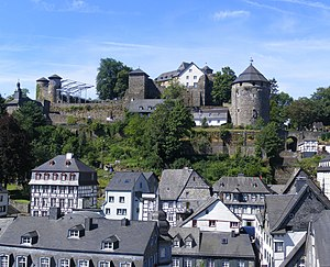 Slate-roofs of Monschau town centre and castle. The castle's courtyard in preperation for Monschau Open Air Klassik music festival