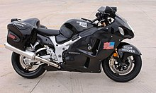 Side view of a modern sport motorcycle with enclosing bodywork, painted black with a US flag on the side, a decal in the shape of the state of Oklahoma, and the legends Highway Patrol and State Trooper