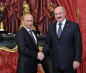 Belarus - President Alexander Lukashenko, right, shaking hands with Russian President Vladimir Putin, left, in 2012