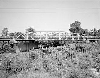 U.S. Route 412 - This 1934 Parker pony truss bridge formerly carried US 412 over the Cache River, but was rated structurally deficient in 1991 and was bypassed in 1995. The main span remains intact.