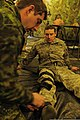 Canadian Forces (CF) Cpl. Jason Foote, left, a medic with the CF Health Services Centre Detachment in St. John's, Newfoundland, secures a traction splint to Spc. Jacques Baker's leg during exercise Southbound 130221-A-DB144-248.jpg