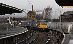 Carnforth - Arriva 144014 arriiving from Leeds.JPG
