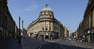 Grainger Town - Central Arcade on Grainger Street with Grey's Monument on the left and Market Street the on right.