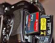 A CompactFlash (CF) card stores digital photographs