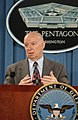 Charles M. Hess briefs the press in the Pentagon on reconstruction progress in Iraq on December 15, 2004.jpg