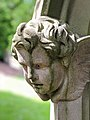 Cherub on headstone, Currie Kirk Burial Ground.jpg