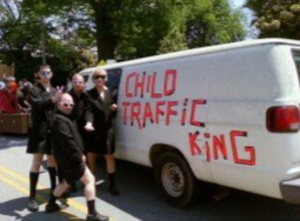 "Sister Louisa's Church of the Living Room and Ping Pong Emporium - Grant Henry (rear center) and his parade float ""Child Traffic King"""