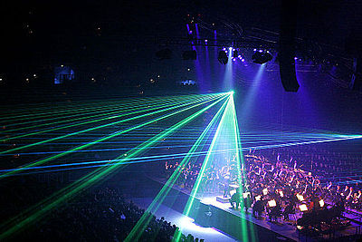 A lasershow is a live multimedia performance. Classical spectacular laser effects.jpg