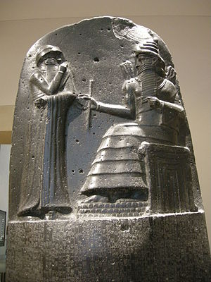 Sceptre - The Code of Hammurabi stela depicts a seated ruler holding a staff.