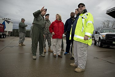 Capito surveys safe drinking water with a FEMA contingency and U.S. Air Force Col. Jerome Gouhin. Congresswoman Shelley Moore Capito, in red, meets with U.S. Air Force Col. Jerome Gouhin, left, the commander of the 130th Airlift Wing, West Virginia Air National Guard, at a Federal Emergency Management Agency 140111-Z-HL234-002.jpg