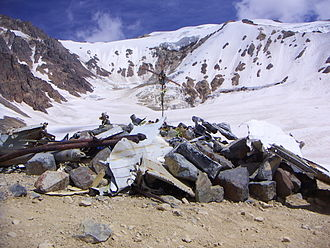 Uruguayan Air Force Flight 571 - View of peak to the west that the three men climbed. The Crash Site Memorial in the foreground was created after the survivors' rescue.