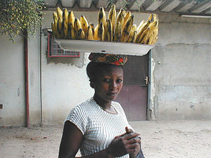 Democratic Republic of the Congo cuisine - A woman carrying bananas.