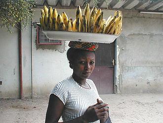 Democratic Republic of the Congo cuisine - A woman carrying bananas.