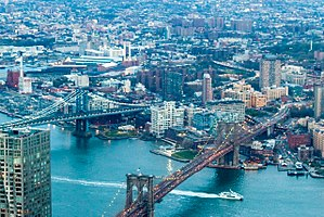 View of Dumbo from One World Trade Center, framed by the Brooklyn Bridge (bottom right) and Manhattan Bridge (center left)