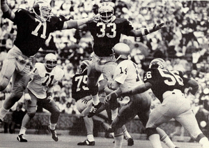 Dave Gallagher (American football) - Gallagher (No. 71) and Carl Russ loom over an opposing QB, 1973