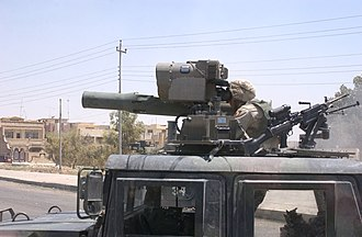 2003 Mosul raid - A soldier from the 101st Airborne Division looks through a Humvee-mounted TOW launcher at the safehouse where Uday and Qusay Hussein barricaded themselves