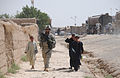 Defense.gov News Photo 100627-A-1619C-264 - Afghan children walk alongside U.S. Army Spc. Steven London from 2nd Platoon Delta Company 1st Battalion 4th Infantry Regiment U.S. Army.jpg