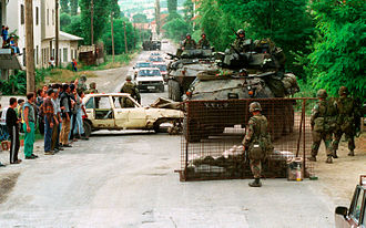 Marines from the U.S. set up a road block near the village of Koretin on 16 June 1999. Defense.gov News Photo 990618-M-5696S-016.jpg