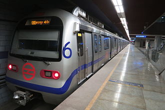 Violet Line (Delhi Metro) - Fleets of Violet line trains supplied by Mitsubishi. Here, a train leaves from JLN Stadium Metro Station.
