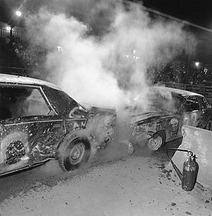 "Demolition derby - Sometimes the action unintentionally spills out of the ""crash zone"" boundaries. Fire extinguishers are conveniently placed for easy access. Many derbies have local firefighting crews standing by in the arena."