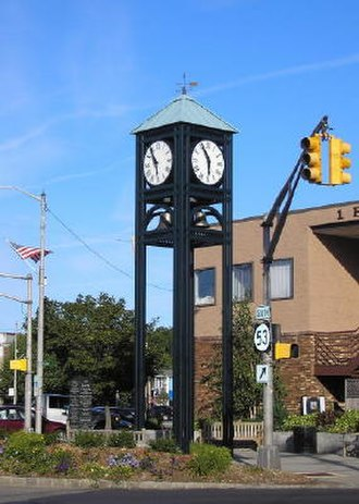 Denville Township, New Jersey - Denville's town clock with sign for Route 53 visible.