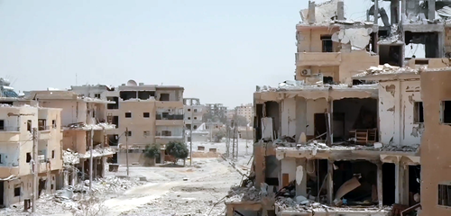 Much of Raqqa suffered extensive damage during the Battle of Raqqa in June-October 2017. Destroyed neighborhood in Raqqa.png