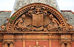 Detail of tympanum, Conway Secondary School.jpg