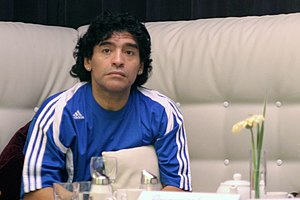 Diego Maradona watching the Germany-Sweden qua...