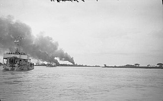 Operation Dracula - Landing craft carry troops up the Rangoon River