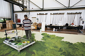 Scenic painting - A scenic painter at work at the Semperoper in Dresden, Germany
