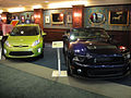 E3 2011 - Fiesta Social Club - green Ford Fiesta and Mustang GT 500 (5831344579).jpg