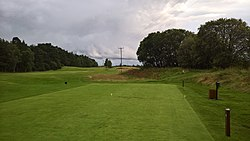 Edzell Golf Club 16th hole tee, 15th hole fairway and disused Edzell railway line.jpg