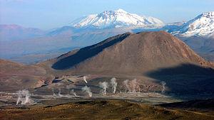 El Tatio - The Andes rise behind El Tatio