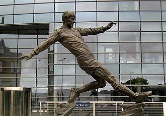 Emlyn Hughes - A statue of Hughes outside Emlyn Hughes House, Barrow-in-Furness