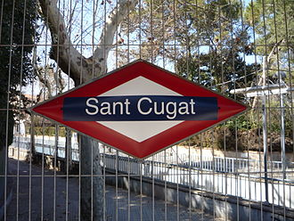 Barcelona–Vallès Line - All the stations on the Barcelona–Vallès Line feature a characteristic rhombus-shaped nameplate. This one belongs to Sant Cugat station.