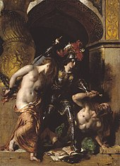 Woman in armour attacks a topless man with a knife, next to a topless woman chained to a wall