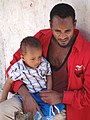 Father with Son - New Christian Market - Harar - Ethiopia (8754031568).jpg