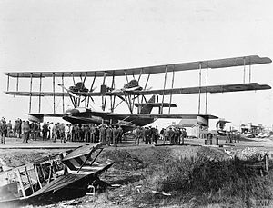 Felixstowe Fury - Fury at the Seaplane Experimental Station, Felixstowe. Wreckage of a Felixstowe F.2A in the foreground.