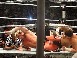 Primo (wrestler) - Primo applying a Figure four leglock on Dolph Ziggler at a WWE live event in San Juan, Puerto Rico.